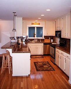 Beautiful Fully Equipped Kitchen with Granite Counters and Stainless Appliances.