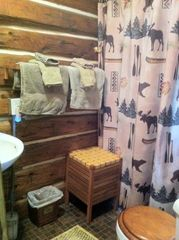 Michigamme River cabin photo - The small, yet comfortable bathroom has a heated floor , a shower, toilet &sink