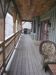 "Highlands house photo - A large covered deck provides 600 sq. feet of living space with outdoor ""rooms"""