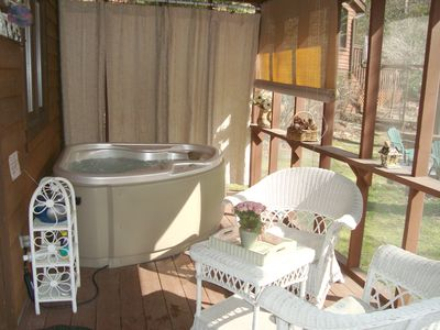 Private Hot Tub for Two on covered, screened back deck with privacy curtains