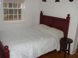 Woodstock house photo - Upstairs bedroom with trundle bed (slides out from underneath bed shown).
