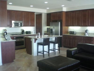 Kitchen with Stainless Steel Appliances and Granite Slab Countertops