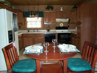 Large kitchen with view of mountains through French doors. - Pigeon Forge cabin vacation rental photo