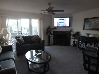 Living room with walkout balcony overlooking inter-coastal waterway