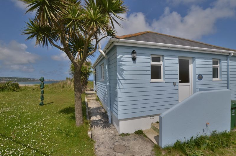 3 bedroom bungalow with views across the Bay to St Ives and Lelant golf course. Parking just beside