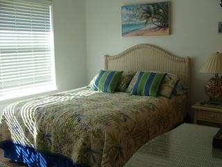 St. Augustine Beach house photo - 2nd bedroom with queen and twin and LCD TV/DVD. Tropical quilts