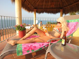 Relaxing on the roof top with bar service - Puerto Vallarta villa vacation rental photo