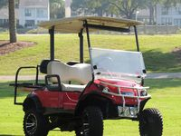 Newly Renovated Coastal decor  Next to the Pool with hot red golf cart.