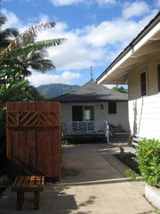 Waialua house photo - View of cottage from beach. outdoor shower on left. main house on right