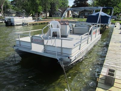 rental pontoon - there are 4 chairs, bench in back, table, captains chair