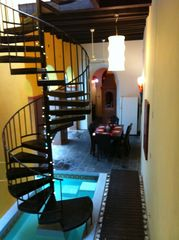San Juan villa photo - View of Circular Stairs, Dining, Kitchen and Rear Pool Area, 14 foot ceilings