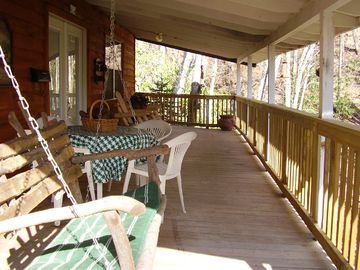 View of front porch overlooking 350 foot creek/waterfalls, wading areas