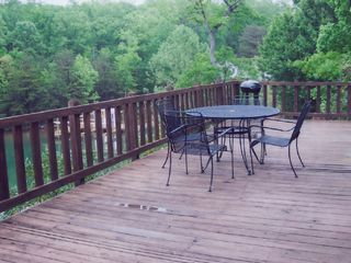 Huddleston house photo - Large deck to enjoy the water views and relax!