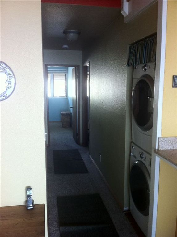 Hallway to bedrooms and washer/dryer