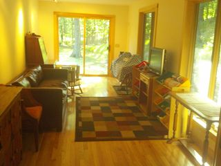 Woodstock cabin photo - Sun room, couch with pull-out queen sized bed, TV with DVD player, toys, piano