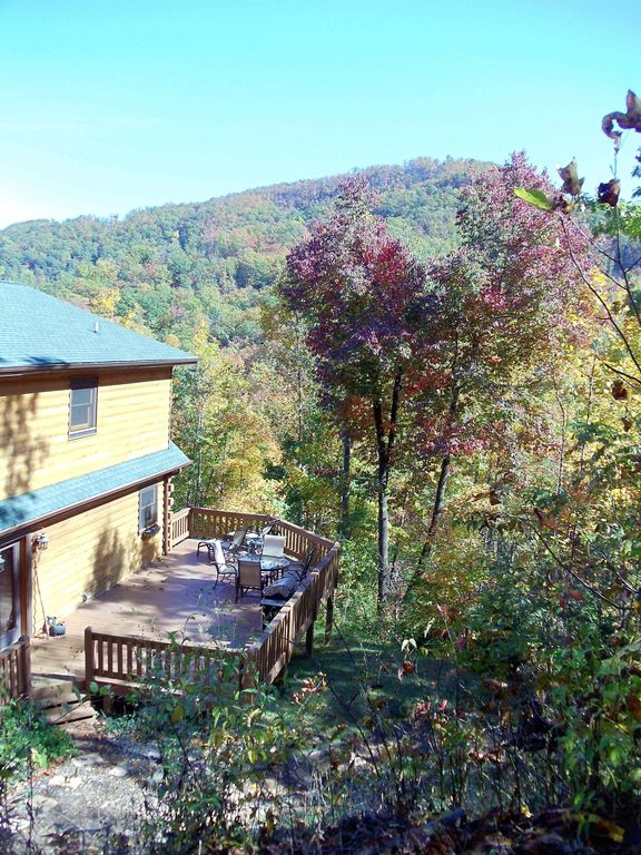 Back of house with large deck for entertaining and views of Creston Mountain.