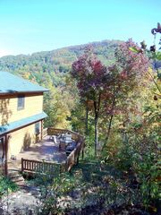 Black Mountain lodge photo - Back of house with large deck for entertaining and views of Creston Mountain.