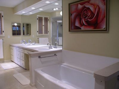 Master bath, w/ tub & shower, also has a private outdoor shower w/ a Gulf view.