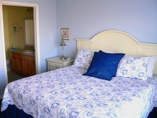 Runaway Beach Resort condo photo - Master bedroom -- king-sized bed, huge walk-in closet, and large flat-screen TV