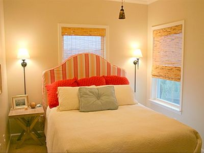 Beautifully decorated guest bedroom with queen bed