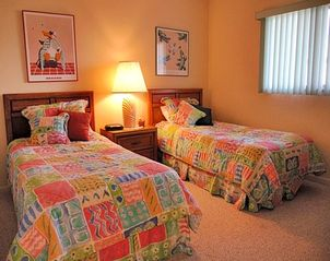 Sanibel Island condo photo - Fun and light guest room with 2 Twins