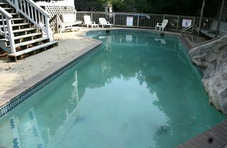Corolla house photo - 40' heated, concrete pool with mini-waterslide and rock waterfall to right