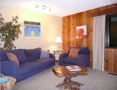 Large living /dining area open to deck with view of Sproat Lake