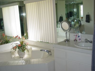 master bath with two sinks,oval tub,seperate shower