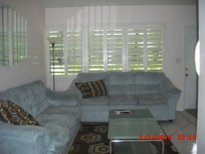 Living room/family room has 50' TV. Couch opens into queen-size sofa bed.