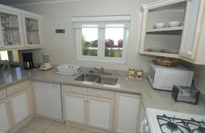 Fully fitted modern kitchen. Includes large 2-door fridge and a dishwasher.