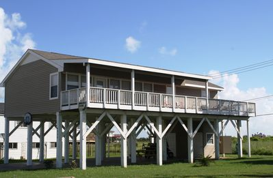 Galveston house rental - View of the front of the house. Large deck looks out on the beach.