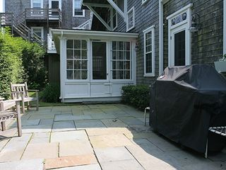 Nantucket Town house photo - Rear Patio with Gas Grille. Rear Screened Porch is in the background.
