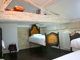 Naujan-et-Postiac farmhouse photo - Kids' dorm with 4 antique italian beds. Plenty of books + board games available.