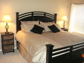 Osage Beach condo photo - Beautifully furnished master bedroom with a flat screen TV....
