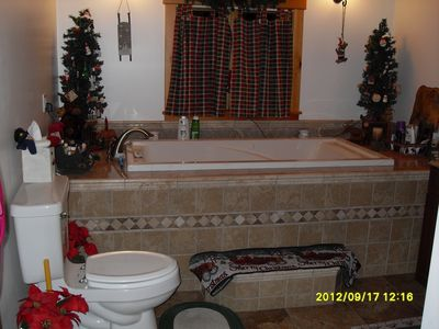 Jacuzzi tub in main floor master bathroom