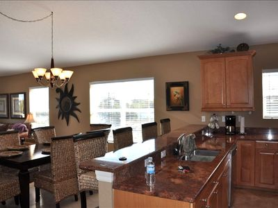 Indian Rocks Beach condo rental - Breakfast counter & 4 stools - Large dining table seats 8