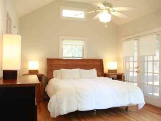 Austin house photo - Vaulted ceilings in the master bedroom with french doors leading to backyard