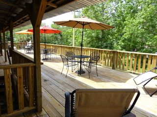 Gulfport house photo - Upper deck just off Kitchen. Tables, Chairs, Umbrellas, Charcoal grill a waitin