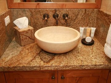 Powder Room with Vessel Sink highlights attention to detail by the owner.