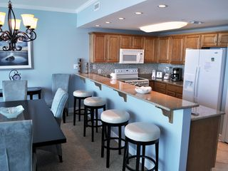 Gulf Shores condo photo - Kitchen and dining area...the old chandelier is still hanging in this picture