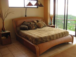 Playa Ocotal house photo - The Cheetah Bedroom with scenic view to the West for Sunsets and the Balcony.