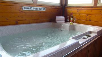 A relaxing time in your personal hot tub inside an enclosed porch.