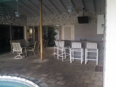 Lanai with dining, bar and TV