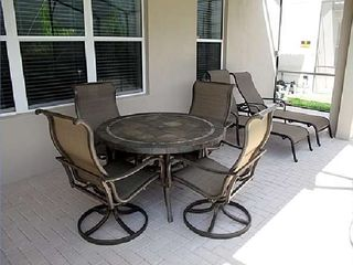 Lanai with table and Lounge Chairs