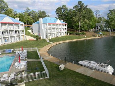 Lake Martin condo rental - View from your balcony of the onsite pool and free boat tie-ups.
