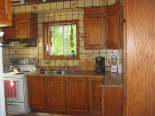 Saint-Sauveur cabin photo - Kitchen looks out toward the lake.