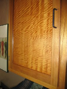 Handcrafted kitchen cabinetry in African Satinwood and Mahogany.