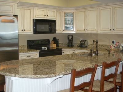 brand new just renovated - new distressed cabinets and granite countertops