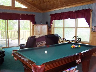 Game room, pool table showing entrance to balcony.