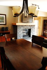 Canmore condo photo - Dining living area - Fireplace